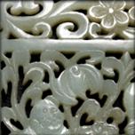 Plaque en jade céladon ajourée à décors de frères he he