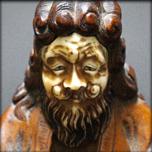A LITTLE OKIMONO FIGURE OF GAMMA SENNIN, LATE EDO 19TH CENTURY